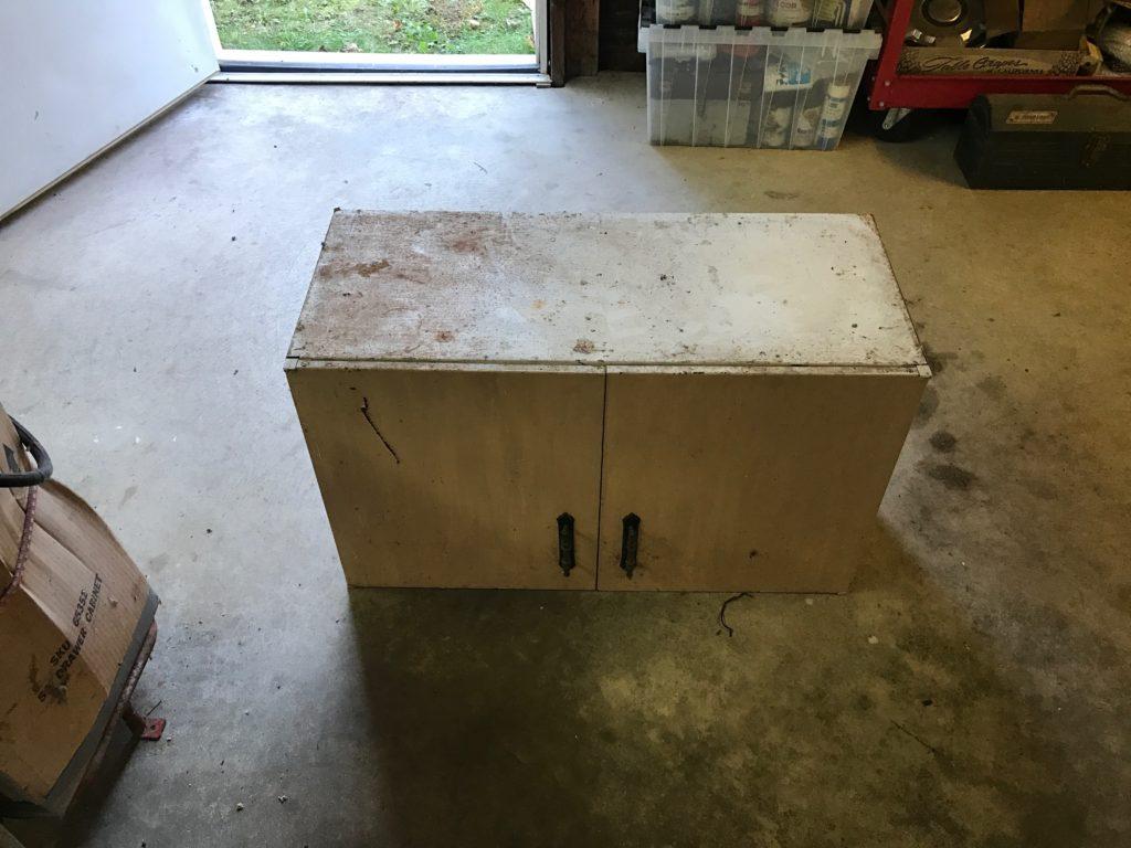 2 door steel cabinet w/2 shelves $25