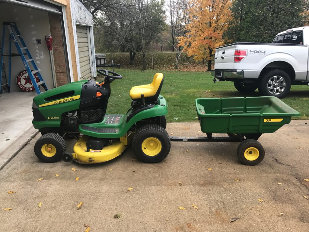 John Deere LA105 with 7P Trailer