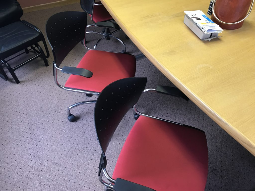 Red conference room chairs